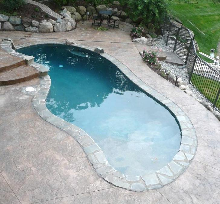 NDK Contracting LLC | Swimming Pool builder Mi | stamped concrete ...